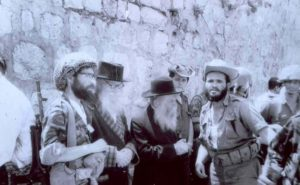 HaRav David Cohen and HaRav Tzvi Yehuda Kook among soldiers at the newly-liberated Western Wall in 1967