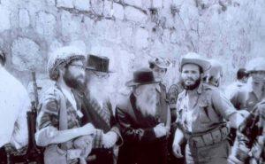 HaRav David Cohen and HaRav Tzvi Yehuda Kook among soldiers at the newly-liberated Western Wall in 1967